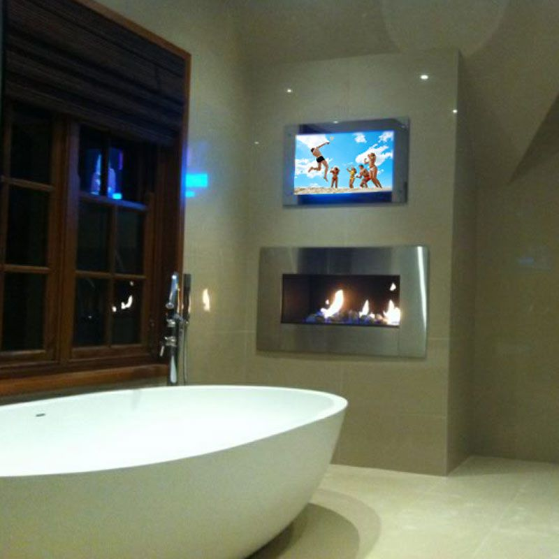 Fireplace AND tv in bathroom - why not?! | Tv in bathroom ...