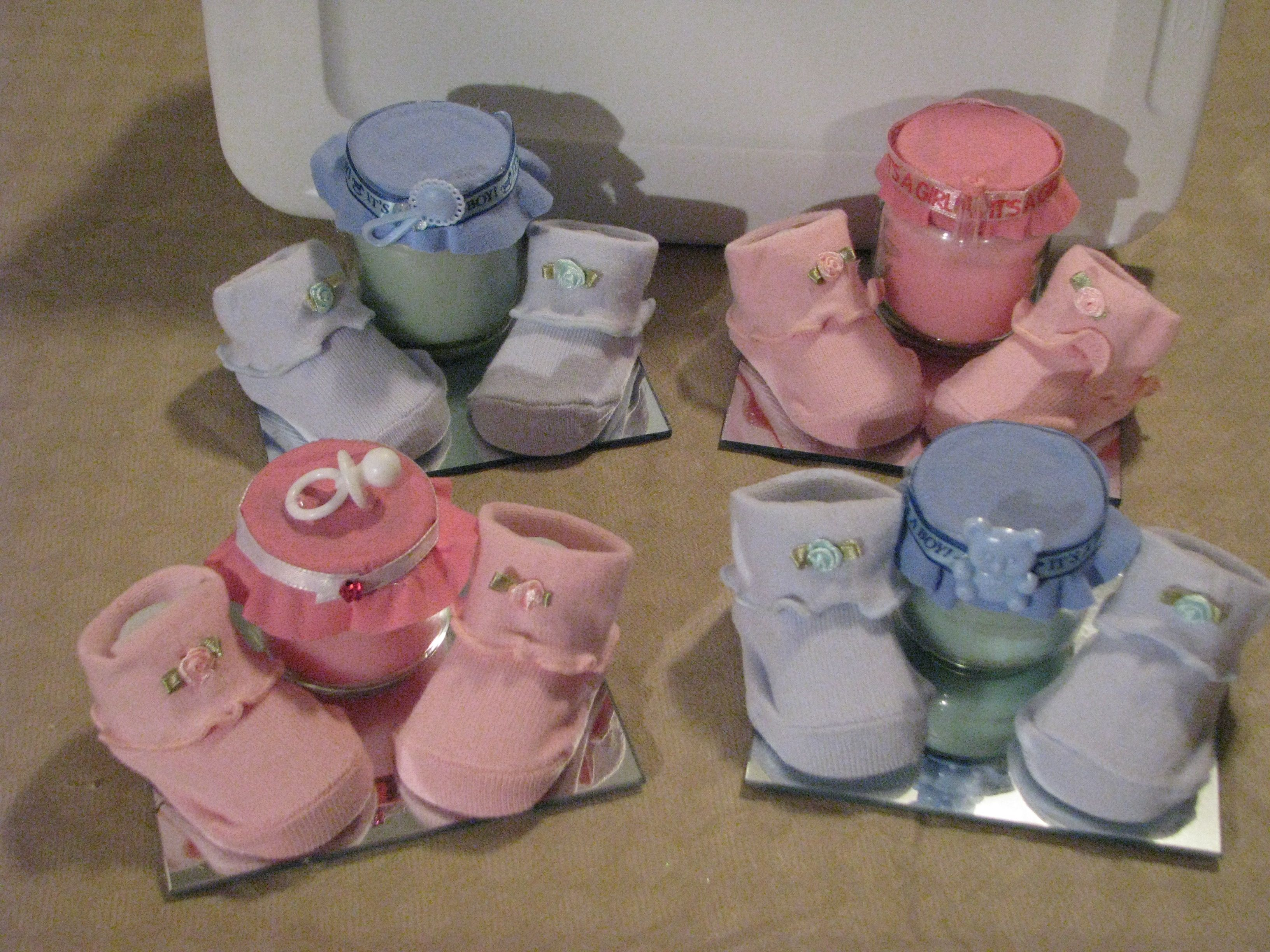 Baby booties a candle and pacifier centerpiece for your baby ...