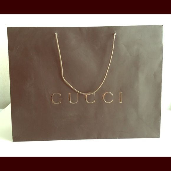 """Authentic Gucci Matte Paper shopping bag Authentic Gucci Matte Paper shopping bag. Large size 19"""" x 14"""" x 6"""" . Great condition. Gucci Bags Totes"""