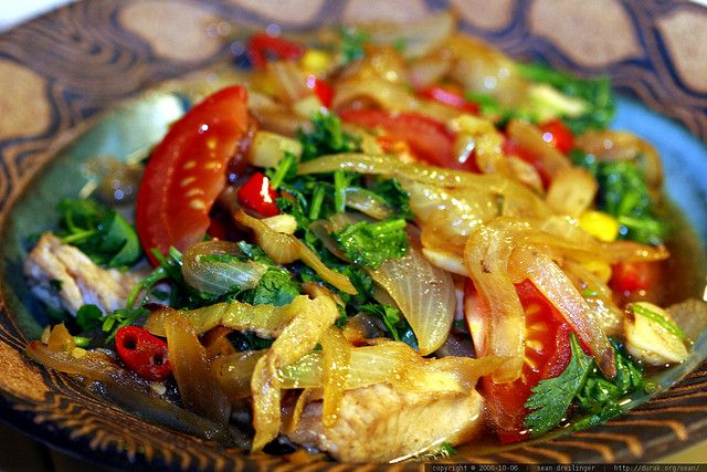 used here (including the recipe!), here, here    view spicy fish recipe - _mg_1699 on a black background.    Spicy Fish Recipe    2 fillets white fish (frozen mahi mahi used here)  1/2 cup chopped chili peppers  1 sweet yellow onion, sliced  1 tomato, sliced   Yummy!  Food for thought!  http://cookwarereview.org