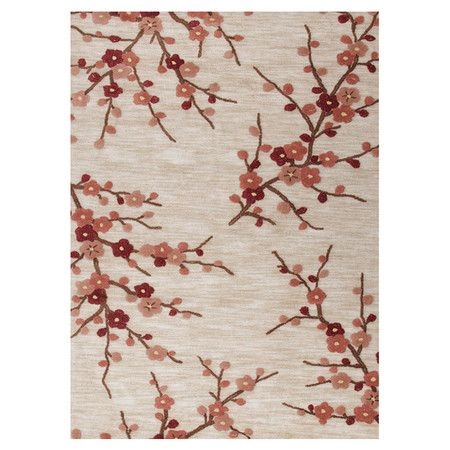 Brimming with garden-inspired style, this hand-tufted rug showcases a blossoming branches motif.   Product: RugConst...