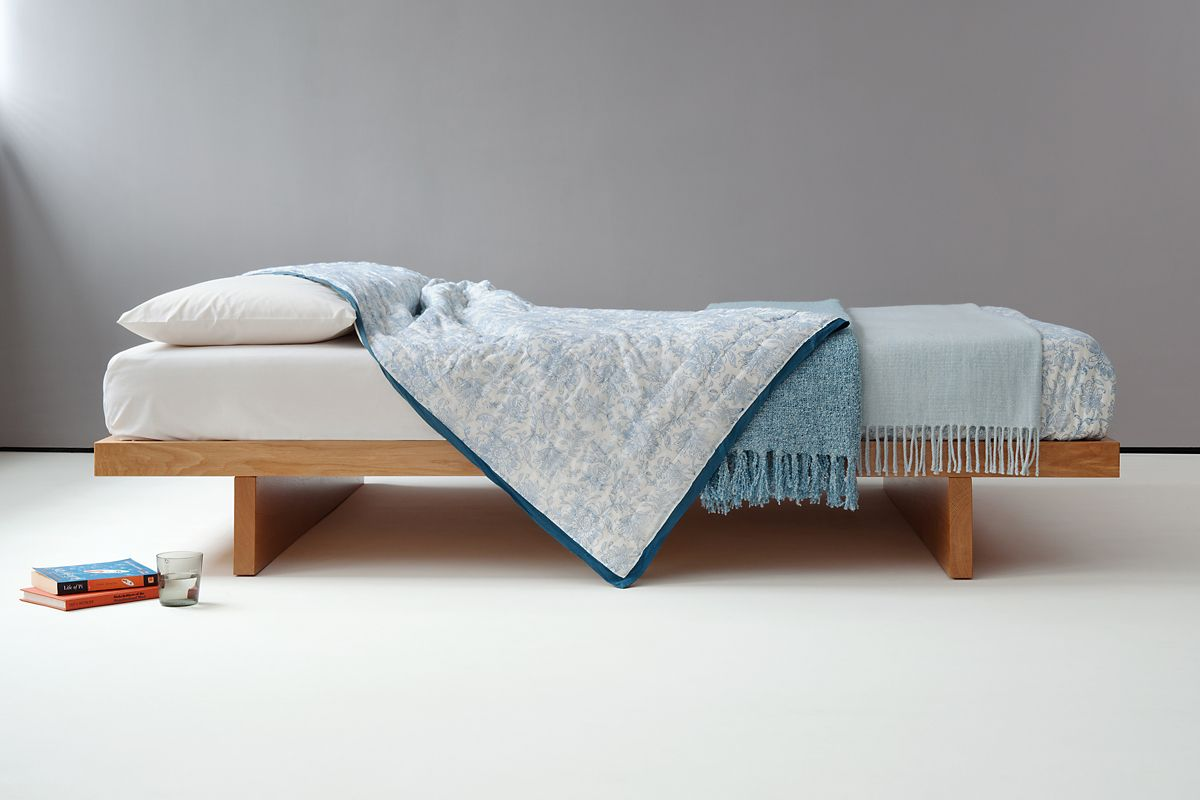 the hand built kyoto bed is a low solid wood japanese style bed