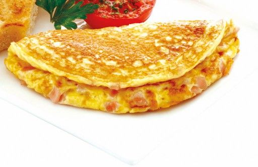 Omelette Lorraine with ham or bacon, cheese and spring onions