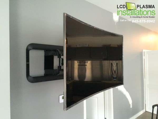 Curved Tv Mounted With Wires Concealed Inside Wall Outlet Installed Behind Tv All Work Was Done By Lcd Plasma Inst Curved Tvs Curved Tv Wall Wall Mounted Tv