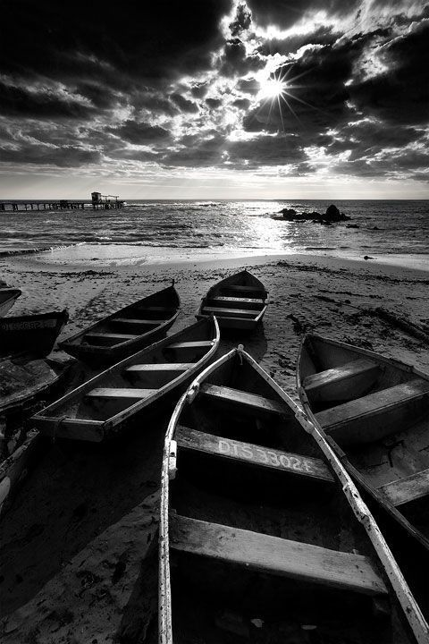 Boats on the beach photo black and white photography