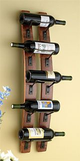 Gorgeous wine rack made from retired wine barrel staves. Love!