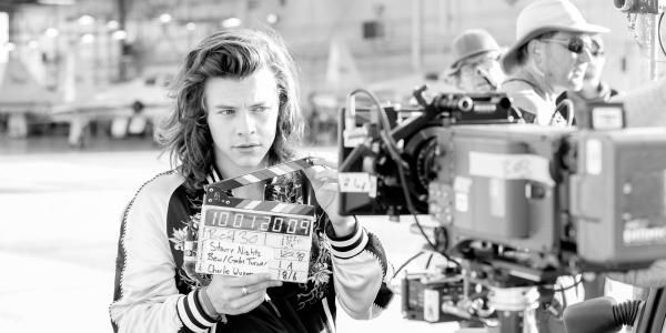 New picture of Harry at Drag Me Down set