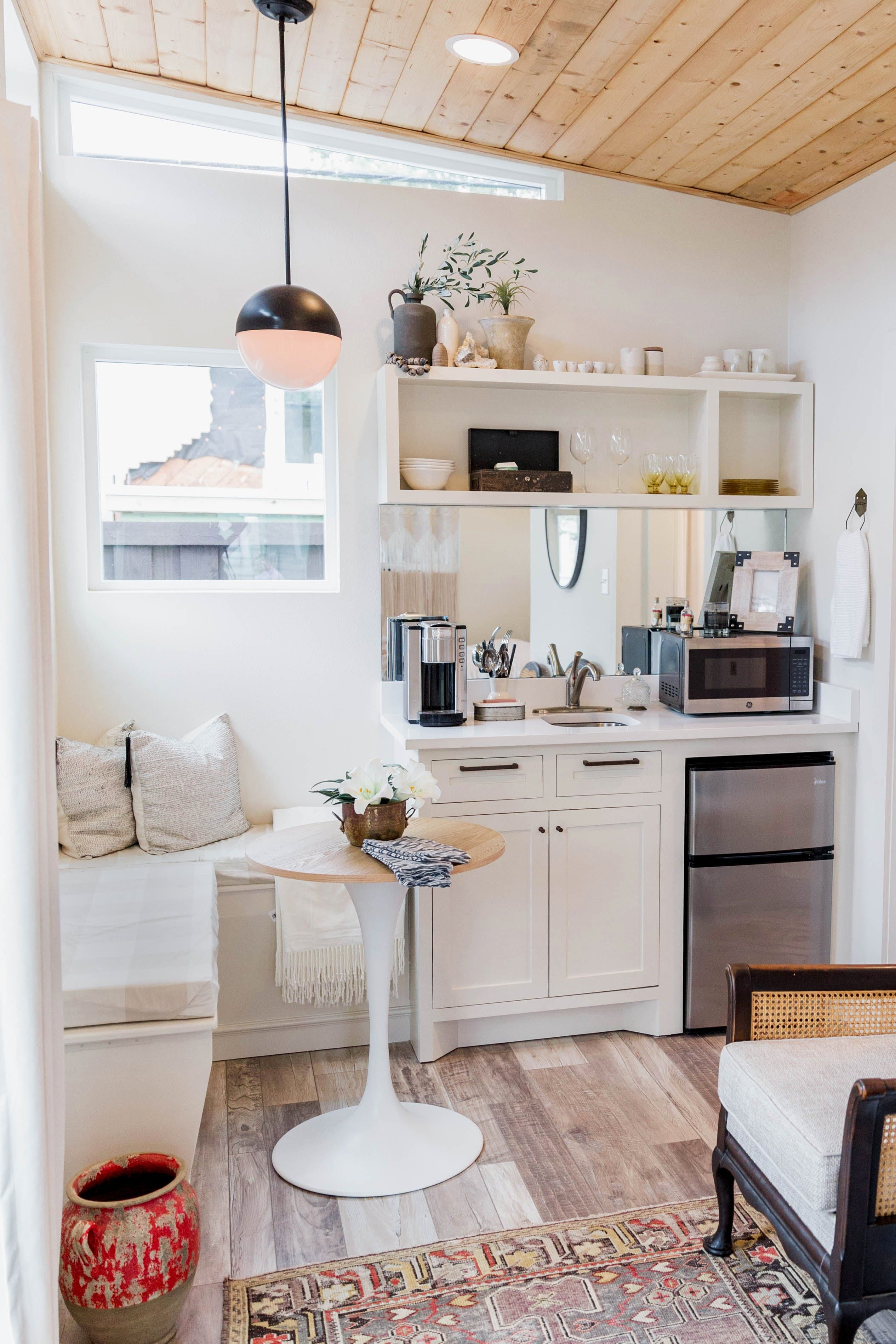 Favorite element the high ceilings and transom windows that flood space with light make feel larger also  cozy square foot backyard tiny house kitchen area rh pinterest
