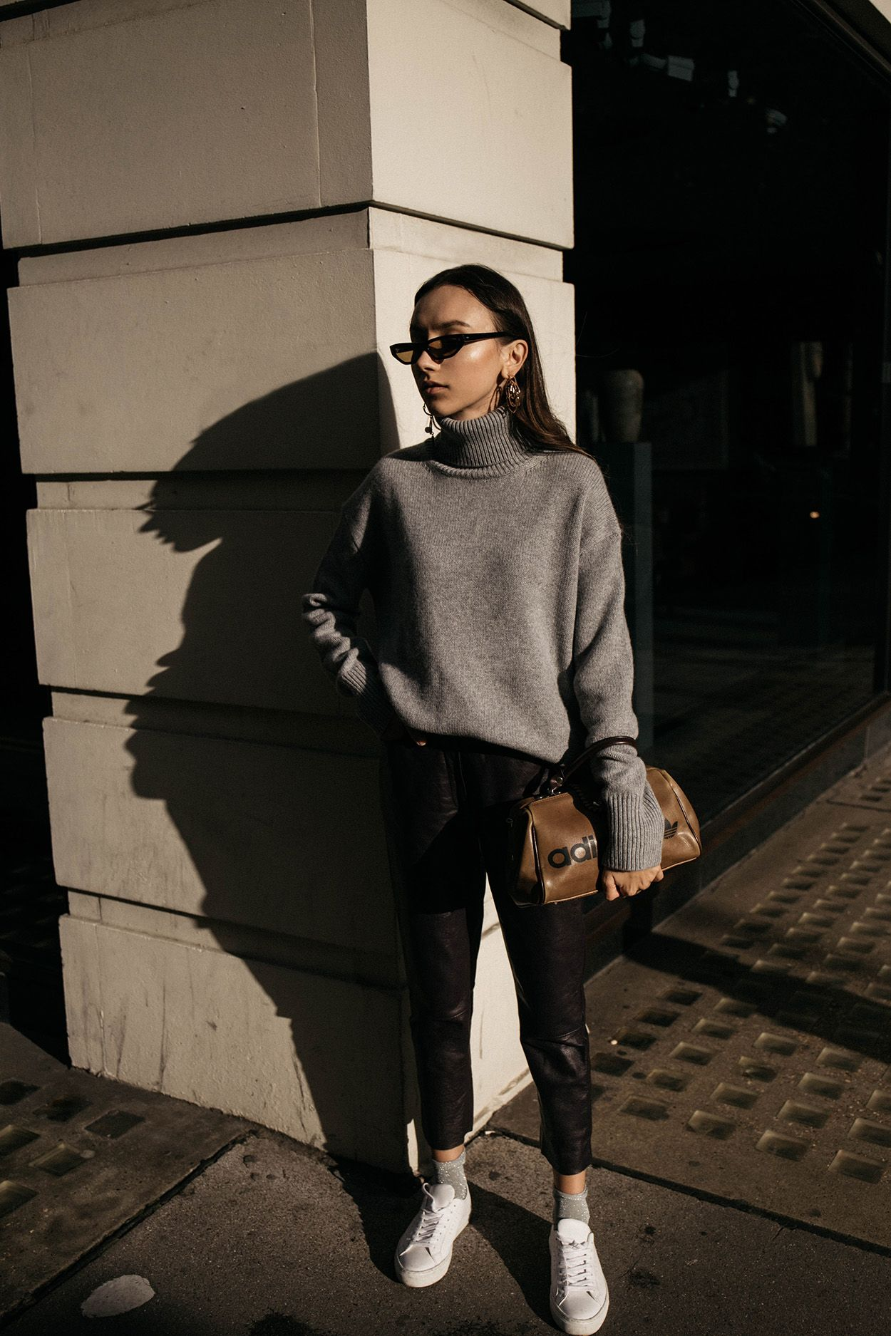 8f5bbfbbab1b How to wear grey cashmere turtleneck sweater with leather trousers Filippa  K sneakers and Matrix sunglasses at London Fashion Week thefashioncuisine  style