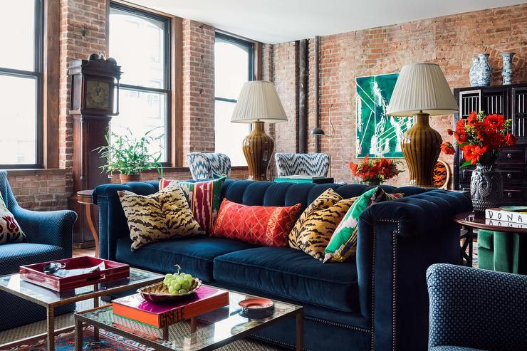 Sapphire Blue Chesterfield Sofa With Tiger Print Pillows And Side By Side Coffee T Blue Sofas Living Room Velvet Sofa Living Room Chesterfield Sofa Living Room