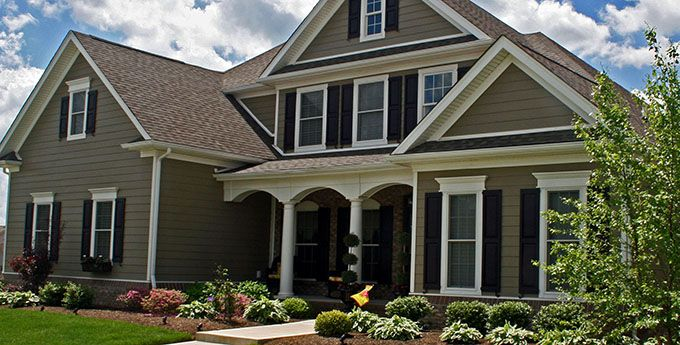 Monterey taupe hardie brown brick black shutters white - Brown house with white trim ...