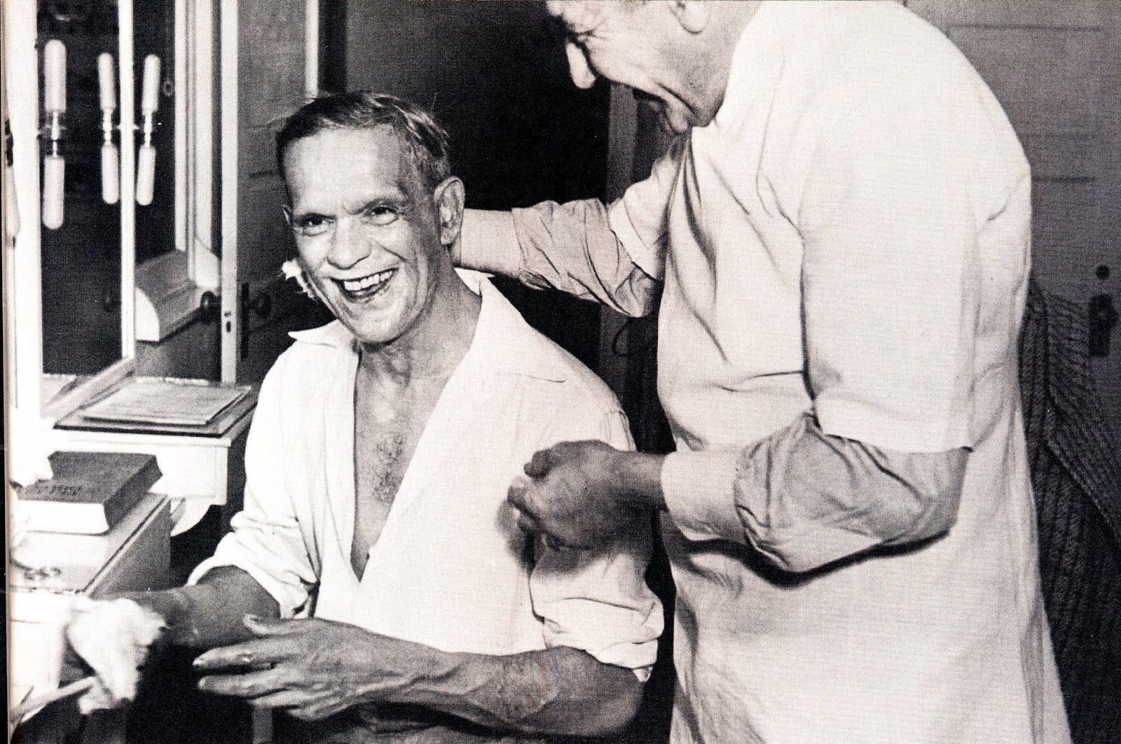 """Boris Karloff is relieved to be out of his Frankenstein make-up.  A behind the scenes still from """"Son of Frankenstein""""."""