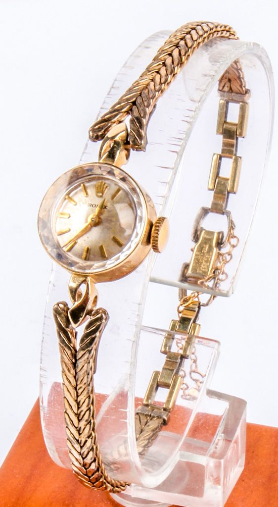 """Lot 1 in the 6.2.15 online & live auction! Fantastic vintage ladies Rolex wrist watch with green Rolex box! Watch piece is 14kt yellow gold, Speidel band is 10k gold filled. Lovely piece! Back of watch is marked """"14k"""", band is marked """"10k G. F. Speidel"""". #Jewelry #Fashion #Shopping #Shopsmall #POGAuctions"""