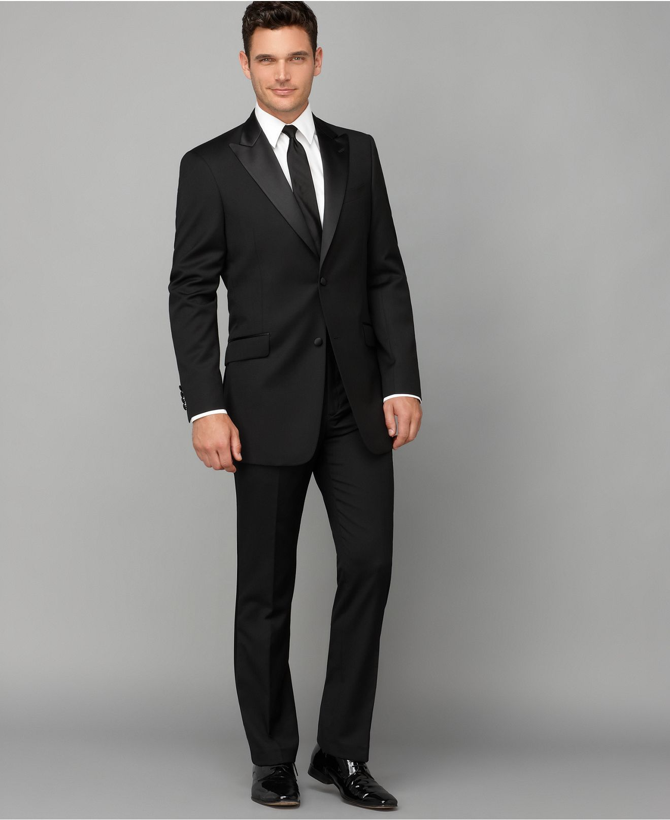 3e4ee16c9516 Give your formal wear a more modern look with these slim tuxedo pants and  jacket from Tommy Hilfiger.