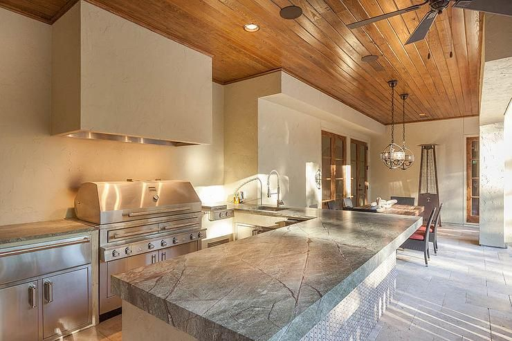Long Covered Patio Features A Plank Ceiling Over An Outdoor Prepossessing Patio Kitchen Designs Inspiration Design