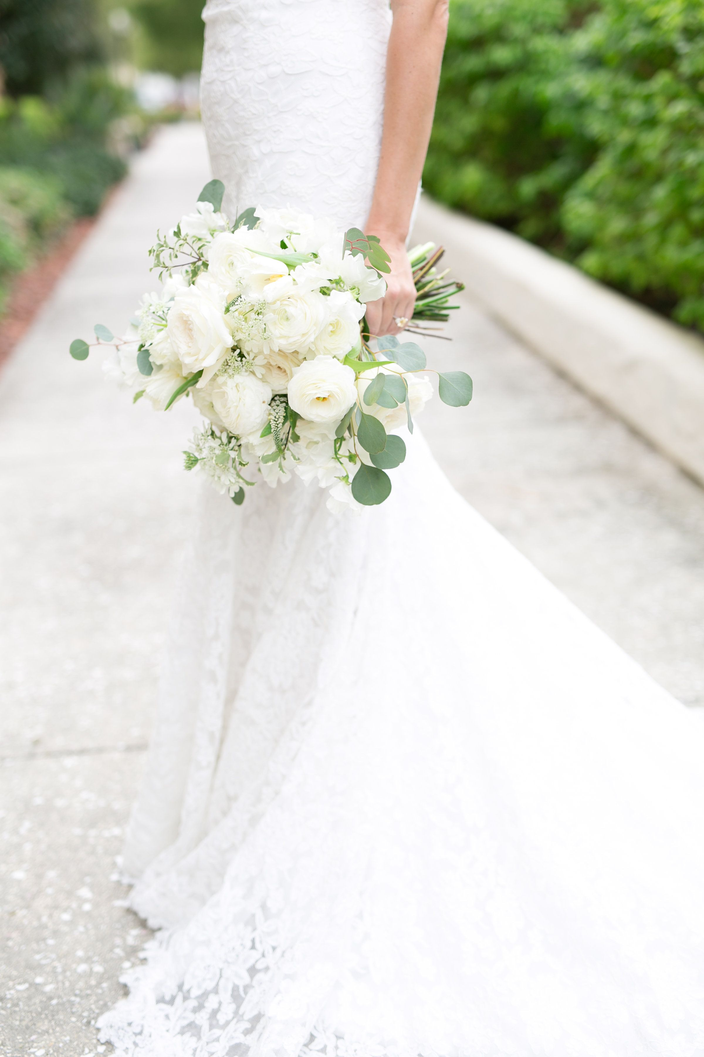 Bride In An All Lace Gown Holds Her Loose And Lush Bridal Bouquet
