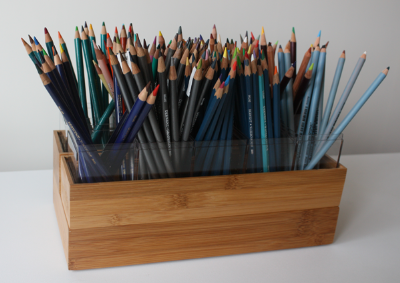 Sharon Eaton came up with this idea for pencil storage, and Doug McCallum of 3Acres.org perfected it. These are Doug's pictures. Thanks Doug for sharing this with us!  Doug used Bamboo boxes and Armac boxes from the Container Store to make this cool storage system.