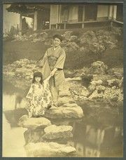 Japanese lady and child walking over stones in Lake [Fair Japan] (1904 World's Fair).