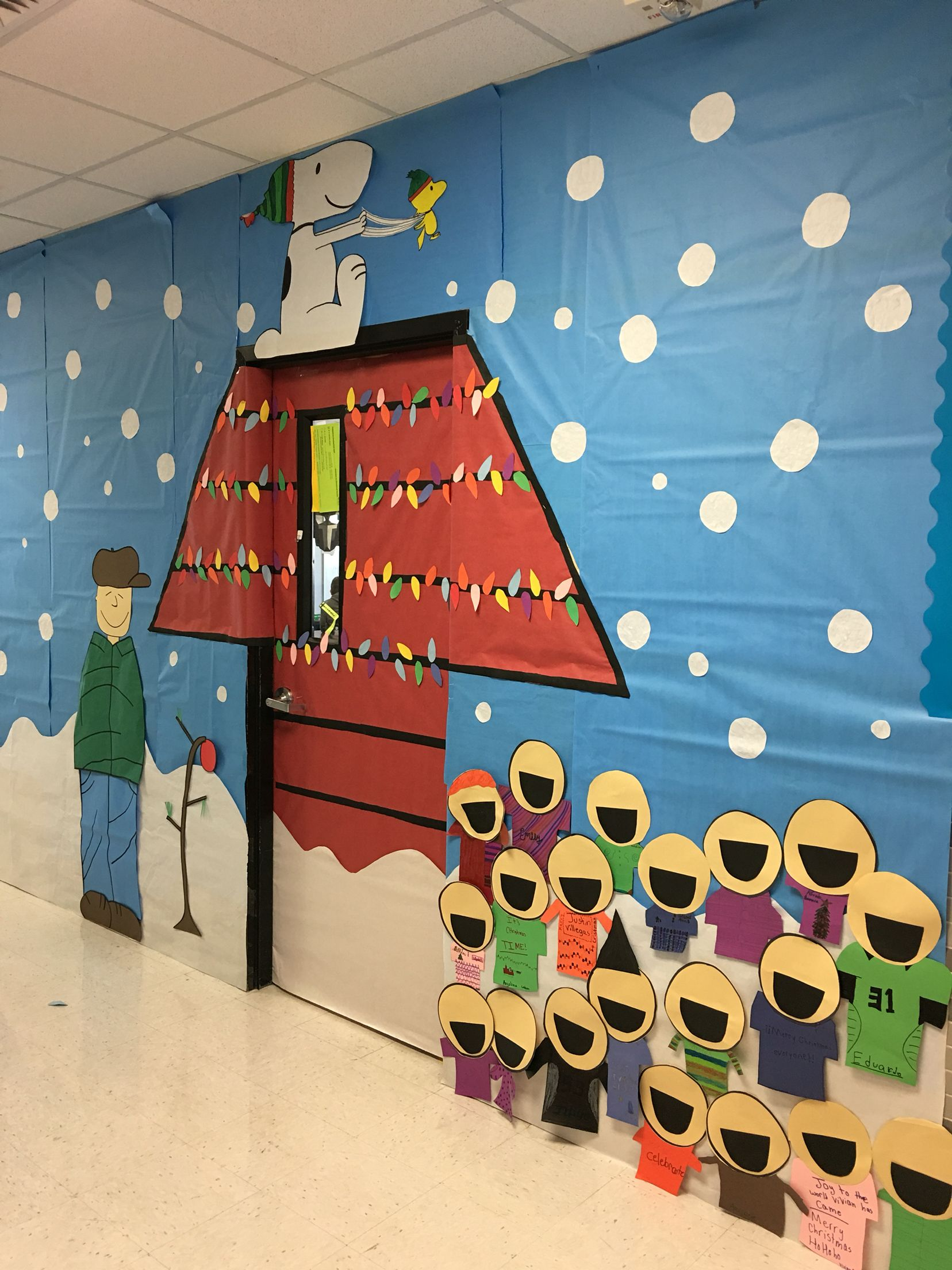Charlie Brown themed door & hallway. My students made the carolers