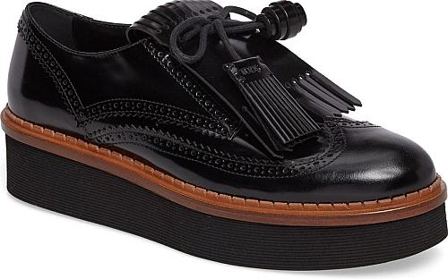 d968a125e8e Women s Tods Kiltie Fringe Platform Oxford in Black. A brogued wingtip  oxford made from glossy leather is detailed with kiltie fringe