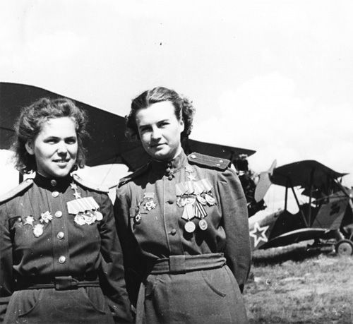 """Soviet pilots from the women's 46th Guards Night Bomber Aviation Regiment, Heroes of the Soviet Union Rufina Gasheva (left) and Natalia Meklin a Po-2 aircraft. Some of the most successful pilots of the Soviet military aircraft on combat missions.  Rufina S. Gasheva (b. 1921) - navigator during the war flew 848 sorties. Natalya F. Meklin (Kravtsov) (1922-2005) - a pilot, 980 combat sorties.""""   The 46th Guards Night Bomber Aviation Regiment also had a nickname:   The Night Witches"""