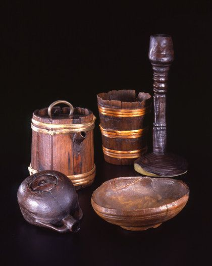 These are Continental items found in a burial at Oberflacht, Germany, late 6th century/early 7th century, but something like these may have been used by Anglo-Saxons. Wooden candle holder, bucket with spout, bowl, and bucket; German.