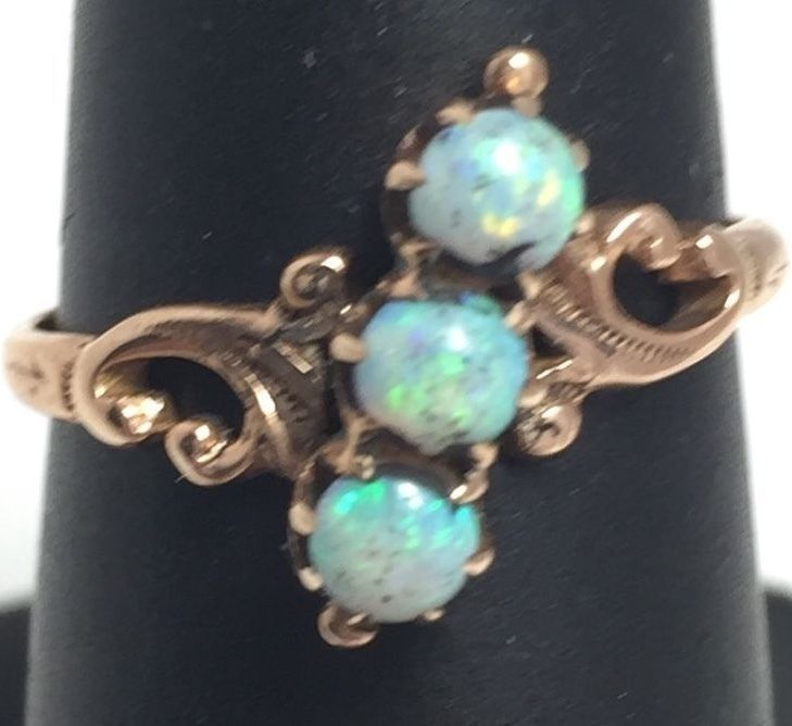 10kt Yellow gold vintage scoll design lady's ring with 3 opals size 5.25…