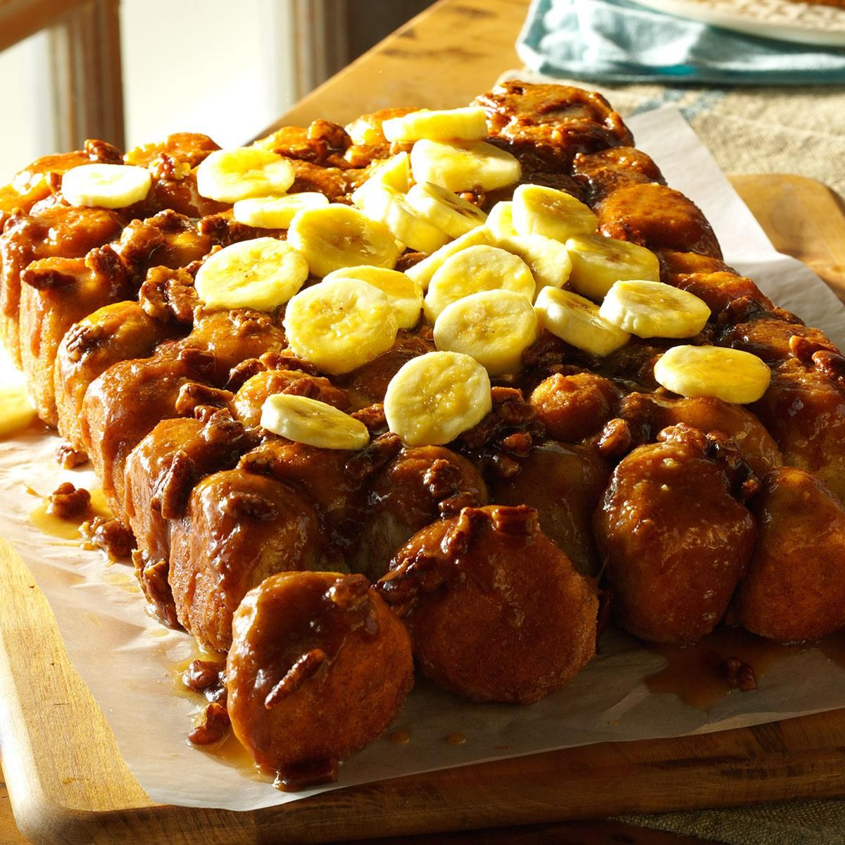 Upside-Down Banana Monkey Bread Recipe -Everyone digs in to monkey bread thanks to its pull-apart shape. We add bananas and pecans in this scrumptious showpiece for a brunch or family gathering. —Donna Marie Ryan, Topsfield, Massachusetts