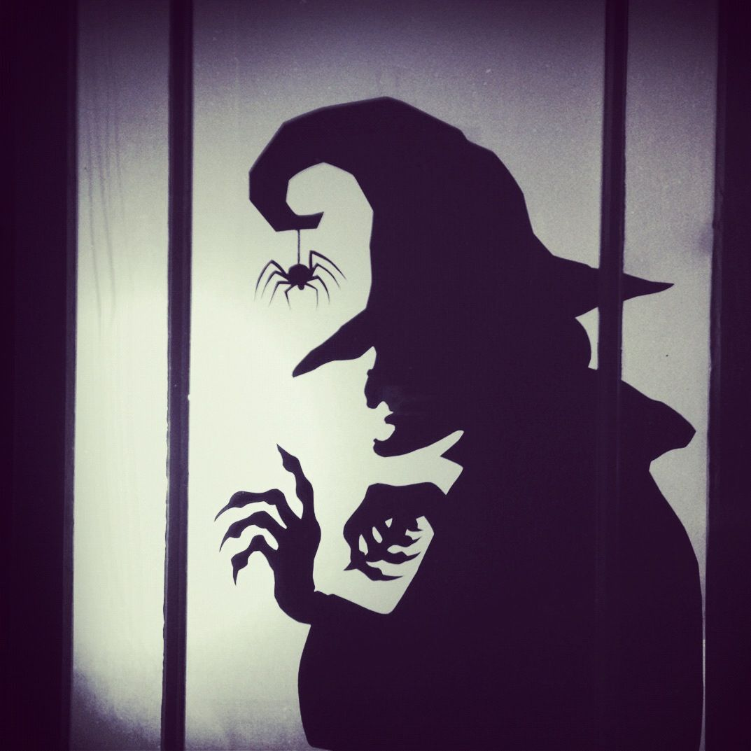 Homemade window stencil of a witch my friend made