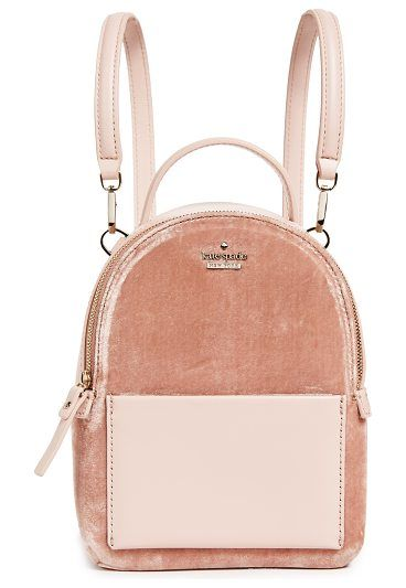 A petite Kate Spade New York backpack crafted in plush velvet and tonal  leather. Slim front pocket. 62279603d460c