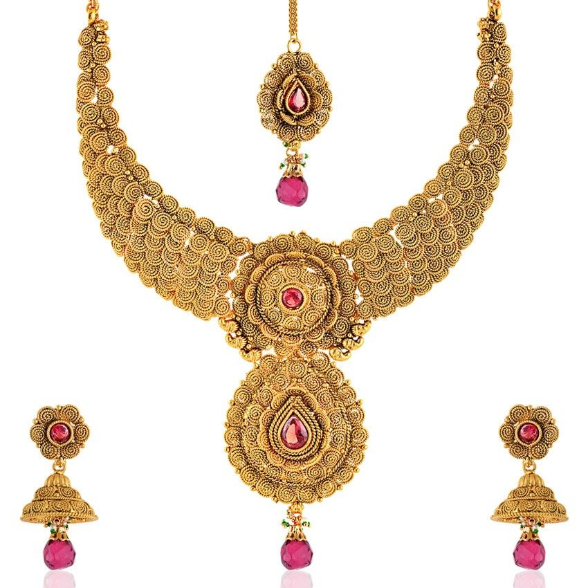 Adorn yourself with this stunning golden coloured Rasrawa Necklace set with Mang Tikka from sia art jewellery. the sheer excellence of the design, will surely make you fall in love with it. Also, utterly feminine in its essence, it will offer your visage a touch of timelessness.