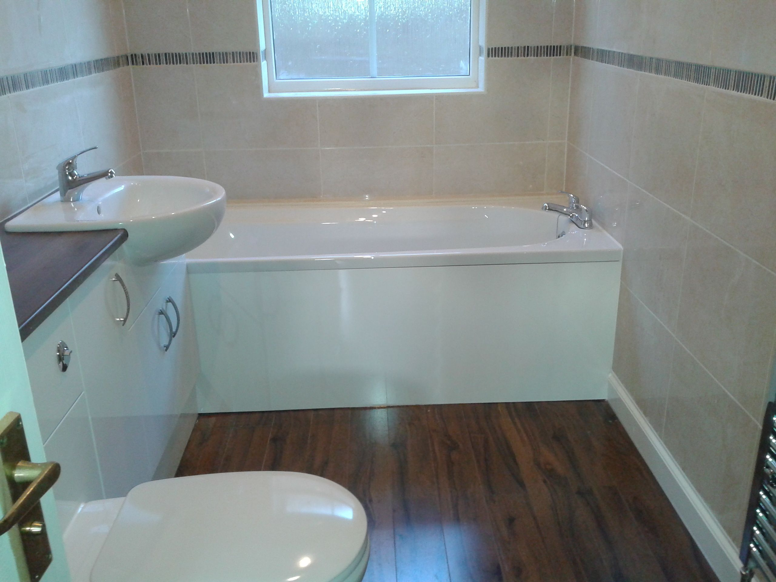White suite, cream wall tiles, dark brown mosaic boarder with toning ...