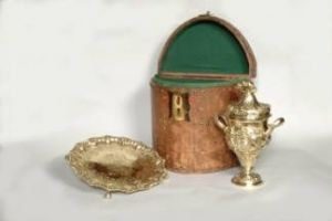 The Prince of Wales cup, cover and salver are silver gilt 'Royal Plate' c.1738. Although unmarked, they are almost certainly made by the Huguenot goldsmith Paul de Lamerie. These three pieces were probably ordered through George Wickes, goldsmith to the Prince of Wales.