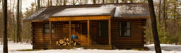 A modern log cabin is cofered in snow at Black Moshannon