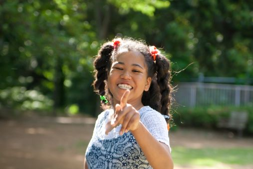 Girl is laughing and pointing her finger
