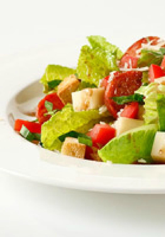 Bella Bruschetta Salad — Bruschetta on French bread is good. Bruschetta ingredients in a crisp salad with romaine and croutons? That's recipe genius.