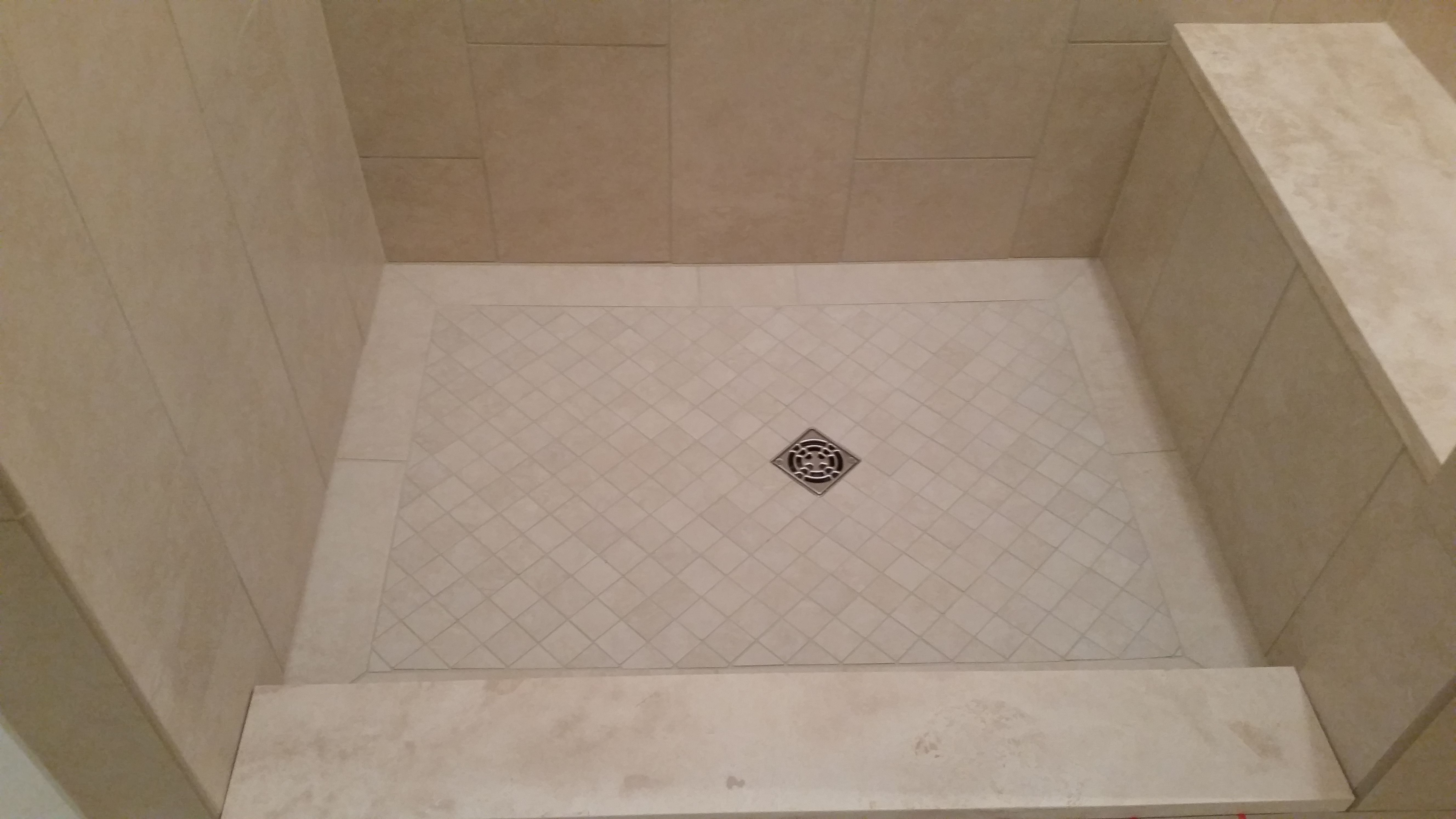 Custom Shower Pan With Travertine Curb And Bench Cap.