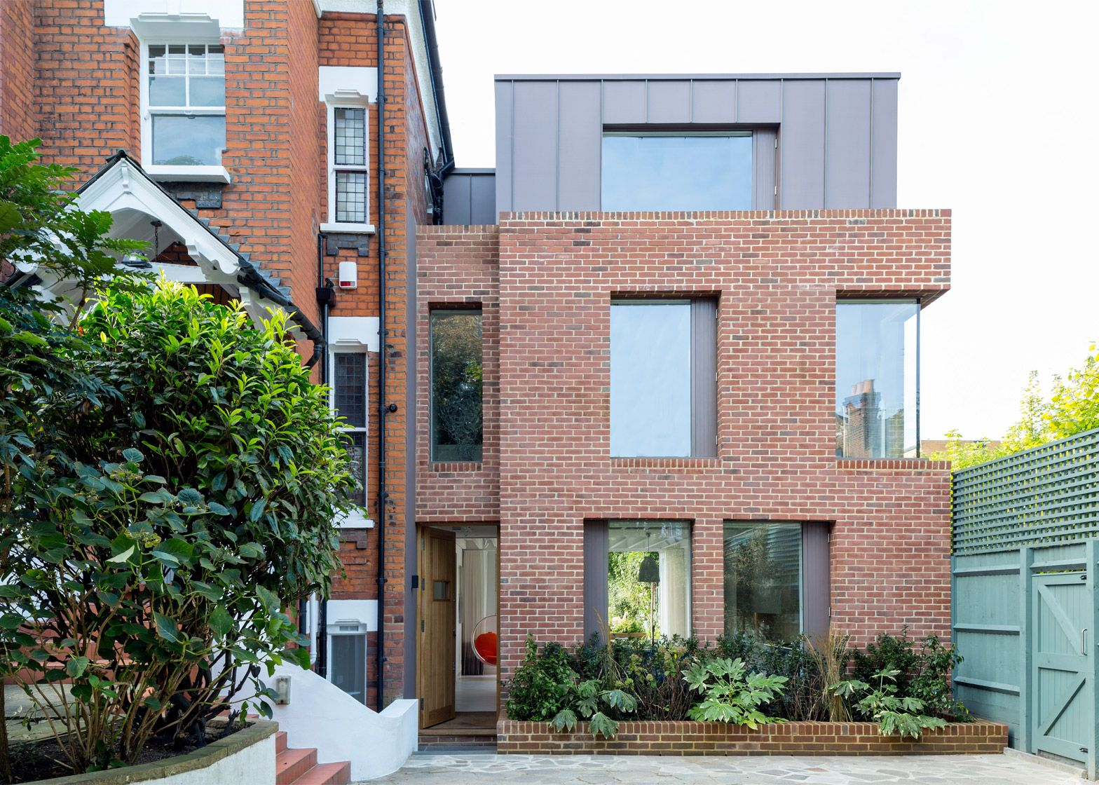 London House Extension By Alexander Martin Features A Double Height Window Wall Dezeen Red Brick House Exterior Brick Exterior House Modern Brick House