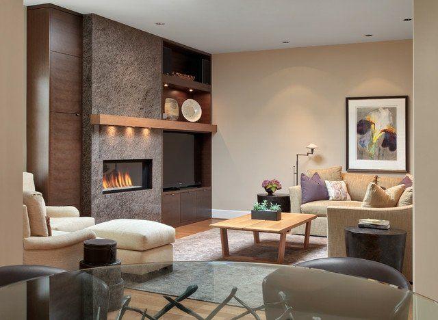 cheminée en pierre grise et meuble télé bois massif dans le salon