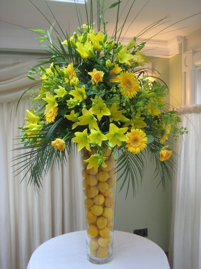 Refreshing all yellow tall centerpiece with asiatic