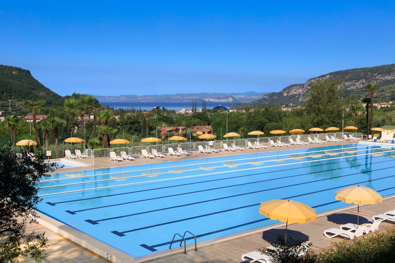 Olympic outdoor swimmingpool (With images) Lake garda