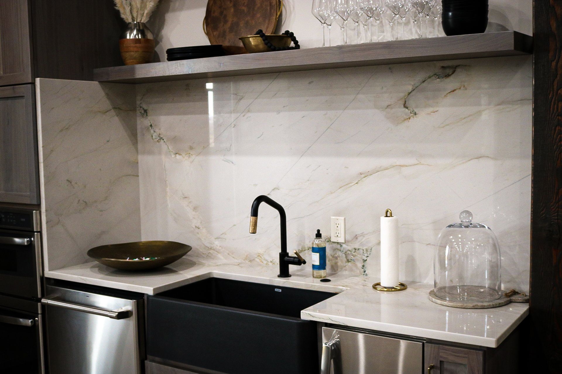 A gorgeous farmhouse sink is paired