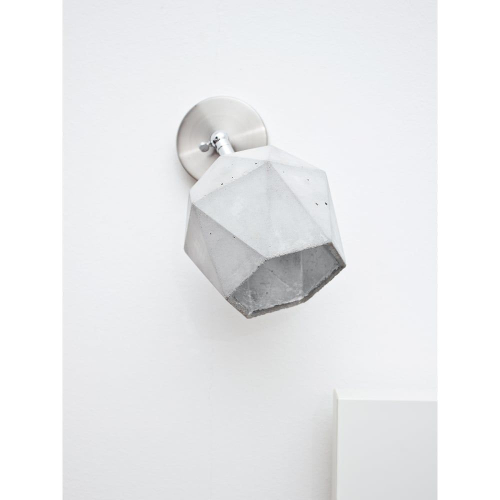 Diamond shaped wall spotlight with light or light grey concrete and