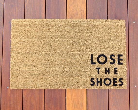 A No Nonsense Mat That Lets Guests Know To Take Off Their Shoes