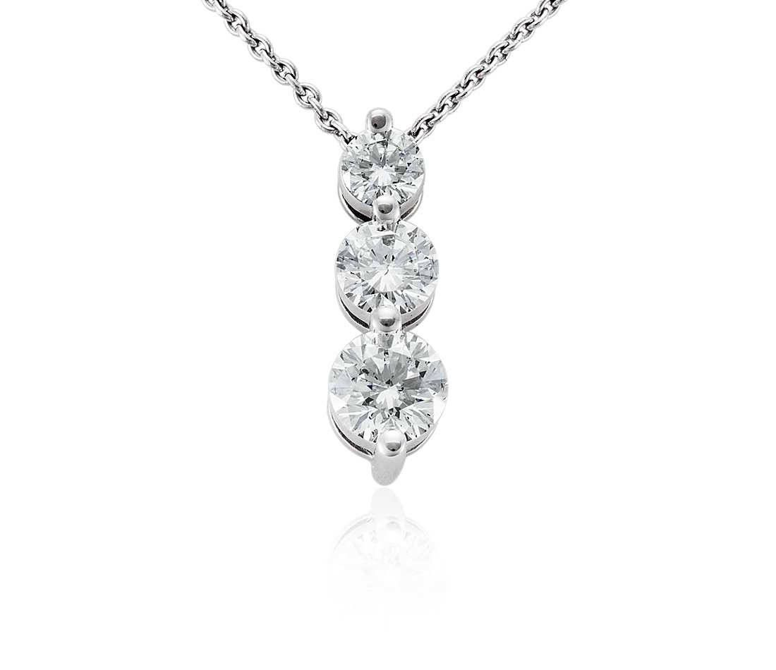 Three stone diamond necklace with three round brilliant f g color vs