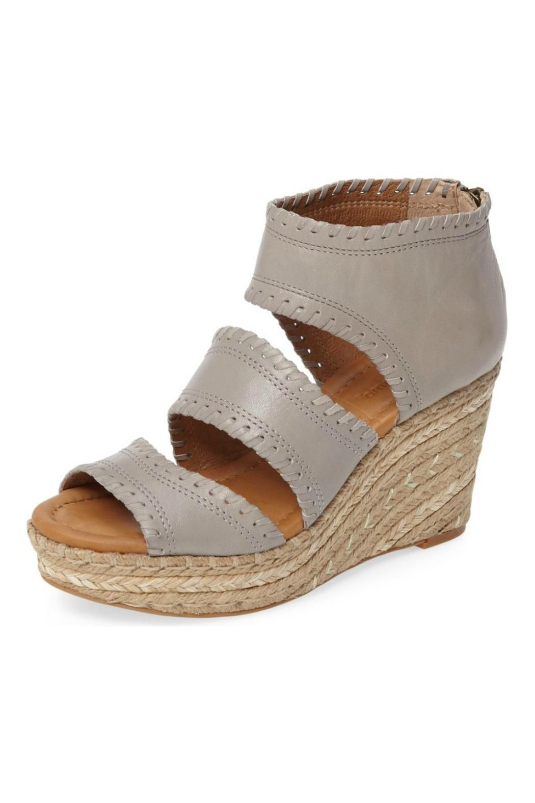"Shimmering metallic fibers are woven into the braided espadrille wedge of an edgy sandal crafted from leather and finished with tonal whip-stitching. With a latex-padded  insole, this espadrille is a comfortable, stylish way to stand a little taller this spring. Back zipper closure. Open toe. Cut-out accents along vamp. Padded footbed. Jute-wrapped platform wedge.    Measurements: Approx. 3.4"" Heel (measurement taken from size 6) Approx. 1.2"" Platform (measurement taken from size 6)…"