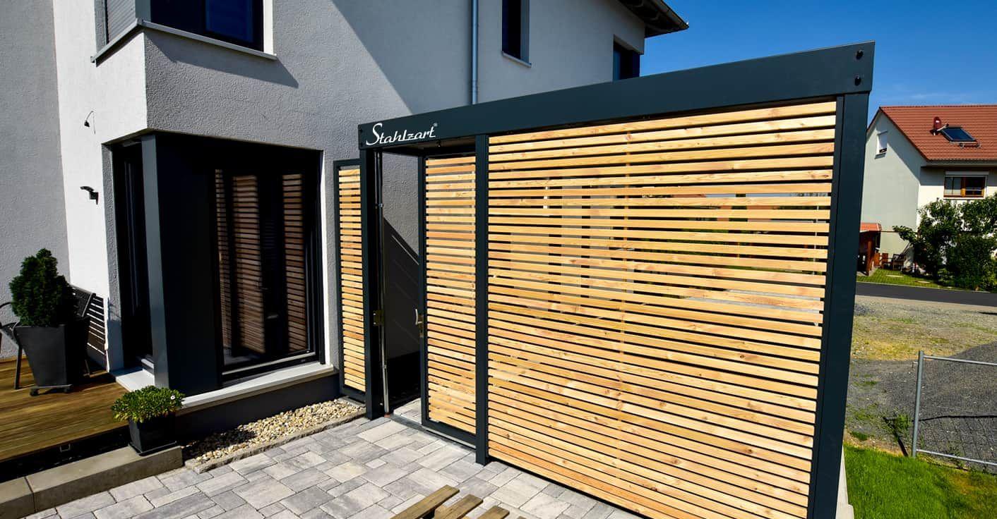 Einzel Carport am Haus aus Stahl Holz Metall · modern