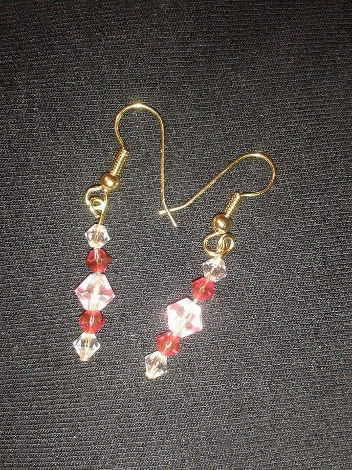 Gold plated earrings with pink beads
