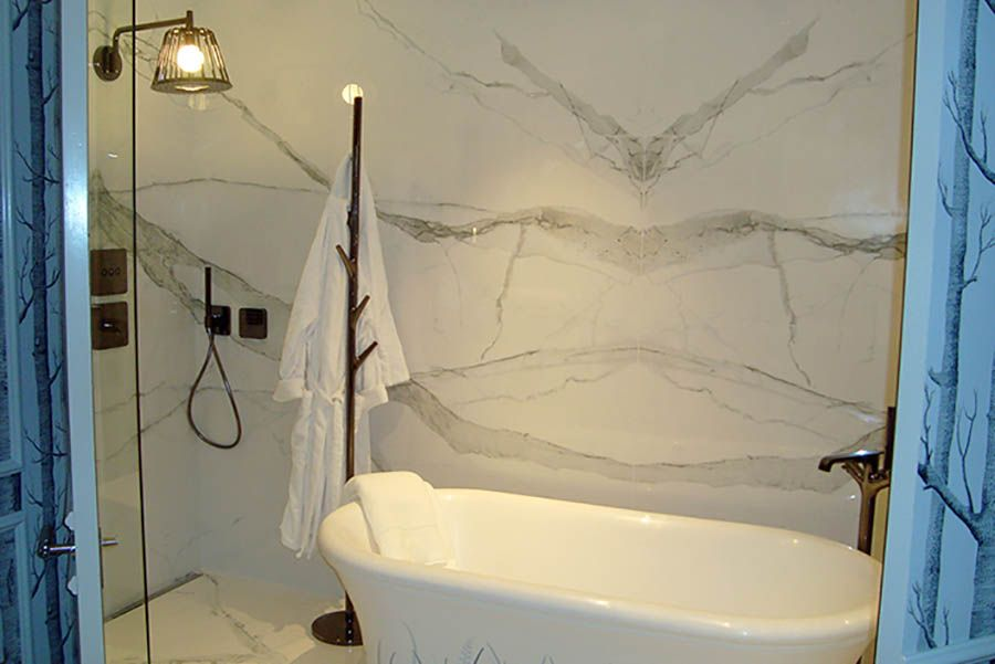 elegant hotel bathroom designed by harrods features lovely twin wash basins and porcel thin white book matched marble tiles bookmatchmarbletiles