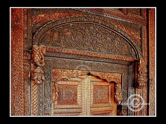 Carved wooden door a kashmiri masterpiece displayed for Door design in pakistan